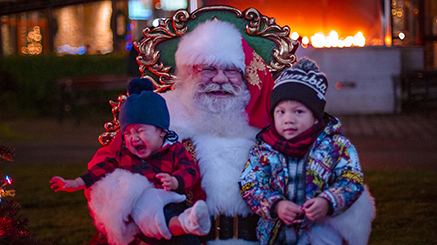 Santa with two small children