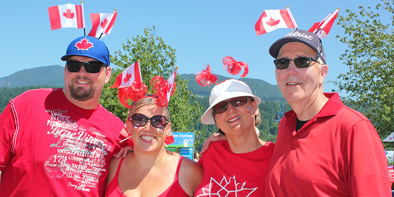Family wearing red and white Canada Day gear