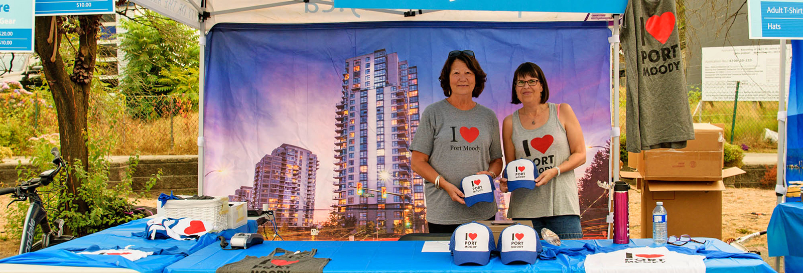 Women selling Port Moody gear