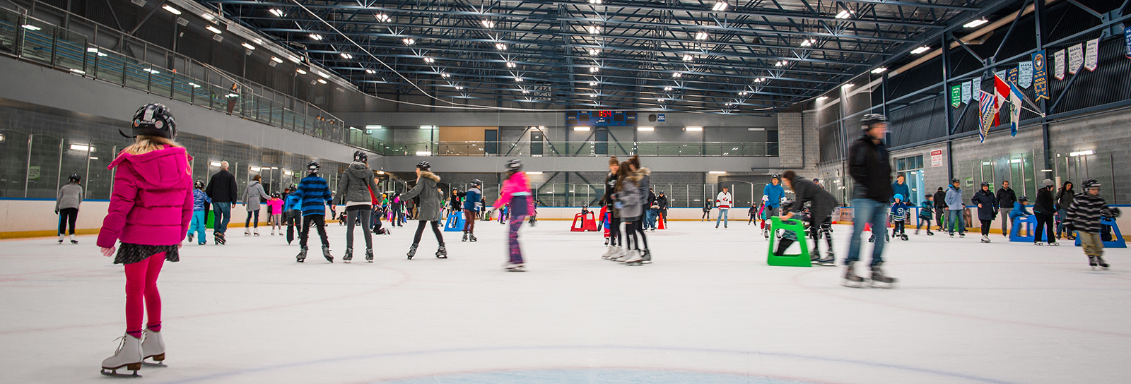 Ice skaters on the ice rink at the Recreation Complex